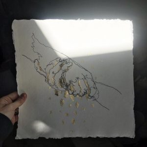 hands holding each other with gold dripping
