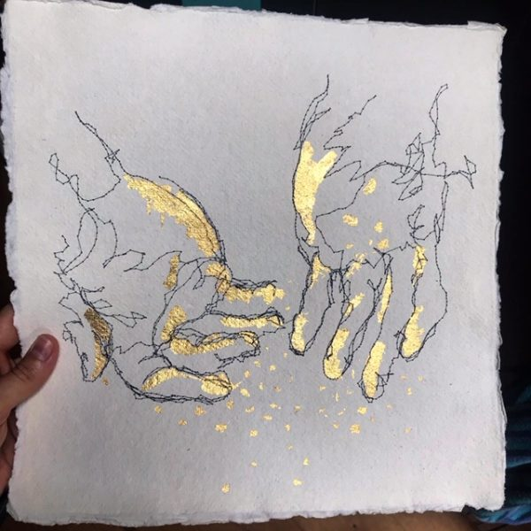 Hands covered in gold